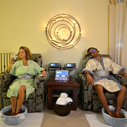 Man and woman relaxing at the Holistic Bio Spa and doing foot detox therapy
