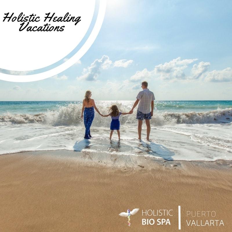 family holding hands enjoying the ocean
