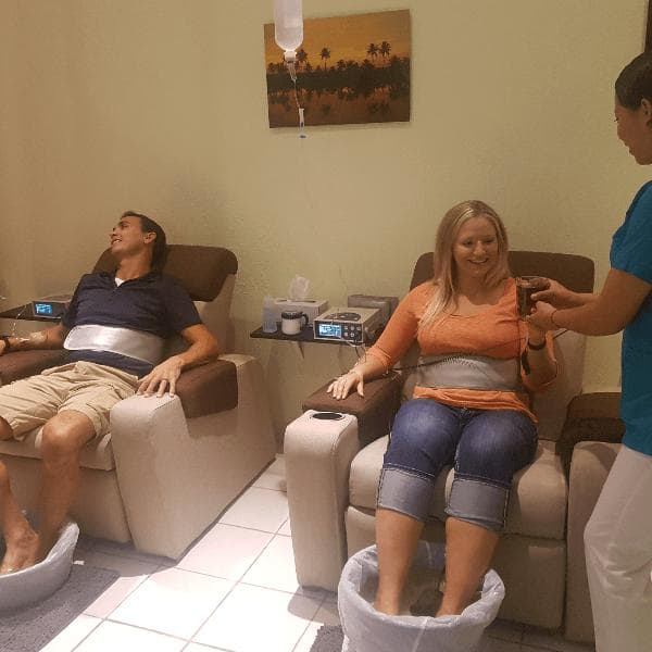 Couple getting intravenous vitamin C drip at the Holistic Bio Spa