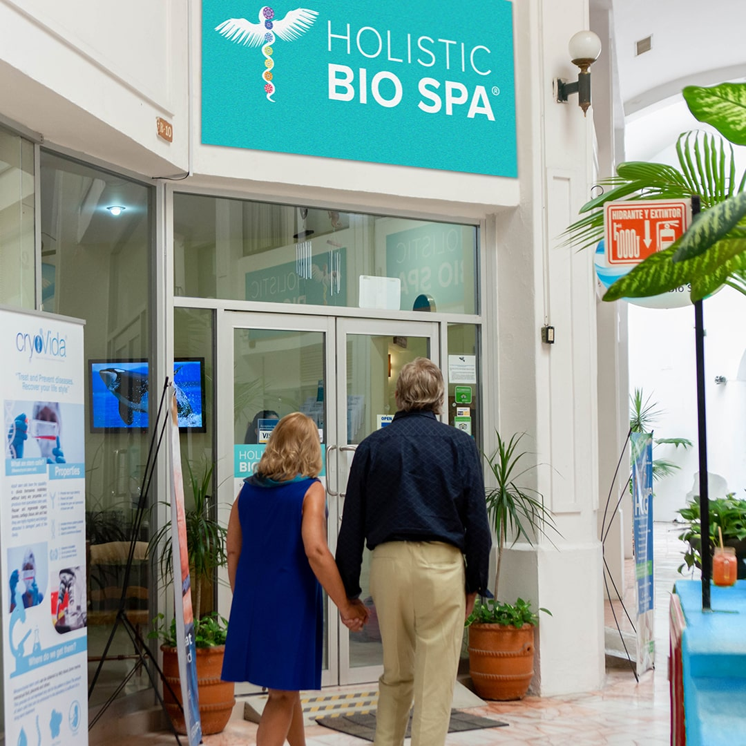 Couple holding hands walking towards Holistic Bio Spa