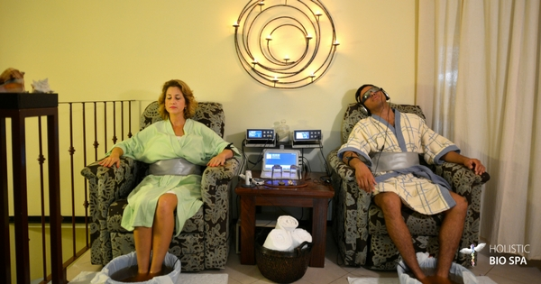 relaxed couple receiving an ionic foot detox