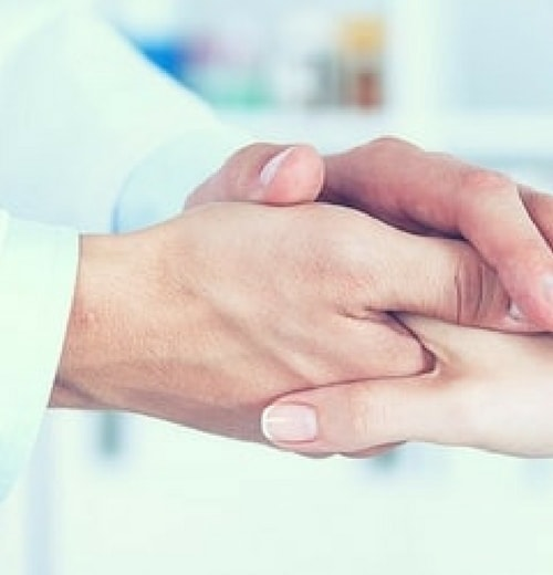 Doctor shaking a patient's hand feeling her feel happy and at ease with her bio-identical-hormone therapy